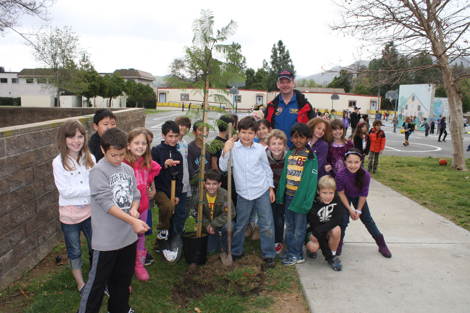 # ci265 Cosmonaut is planting trees in American school 3