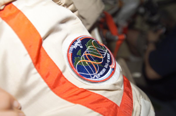# oc097 ISS-15 EVA patches 4