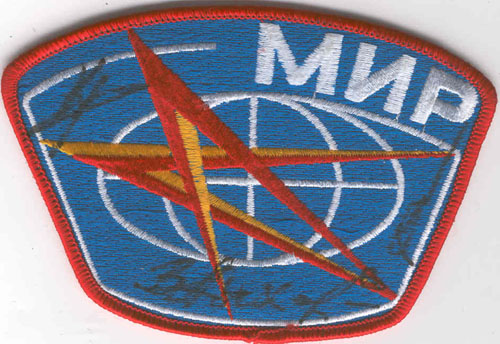 # aup142            Cosmonauts Krikalev,Lyakhov and Savinykh signed MIR patch 1