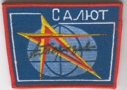 # aup155            Salyut station patches autographed by cosmonaut Berezovoy 1