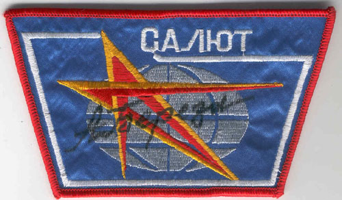 # aup155            Salyut station patches autographed by cosmonaut Berezovoy 2