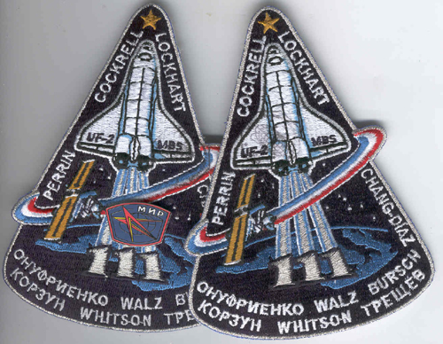 # fp087            STS-111 patches and badge flown on ISS 1