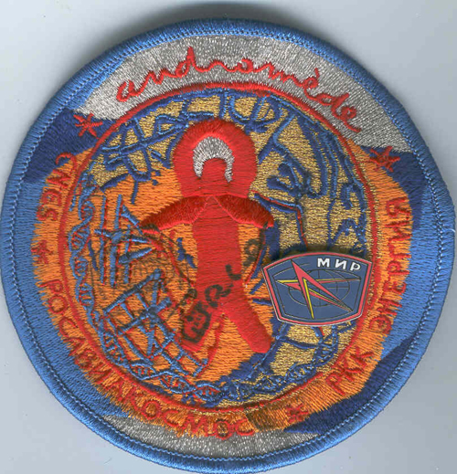 # fp082            Andromede Soyuz TM-33 patch-badge flown on IS 1