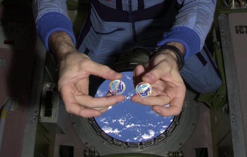 # pf065            Pins and medals flown of Soyuz TMA-2 and ISS 5