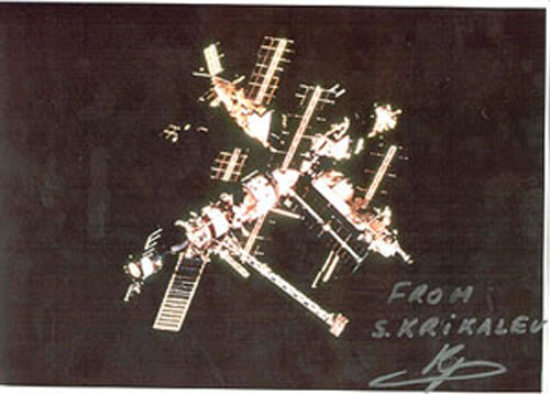 # iph700a            MIR photos signed/notared by cosmonaut Krikalev 1