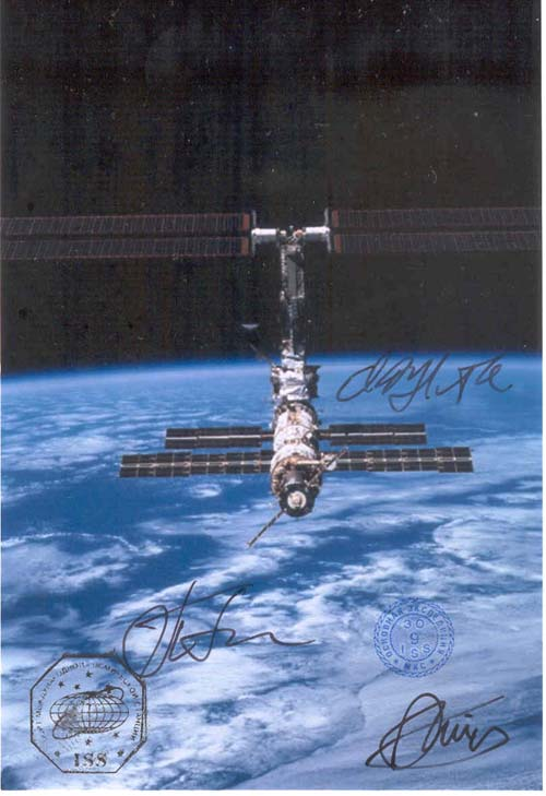 # gp601            Flown ISS photographs signed by Padalka,Finck 1