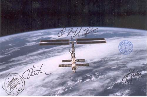 # gp601            Flown ISS photographs signed by Padalka,Finck 2