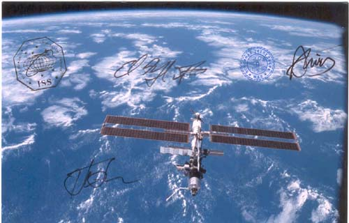 # gp601            Flown ISS photographs signed by Padalka,Finck 3