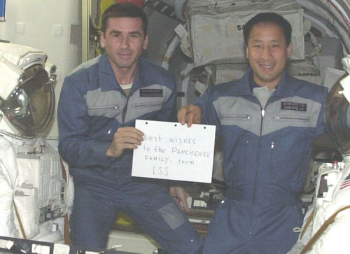 # ic085a            Greeting from Russia-USA team ISS-7 1