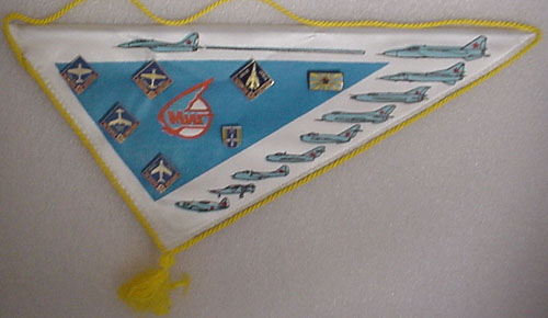 # avpnt116            Mig world tour pennant with attached Mig aircraft pins 1