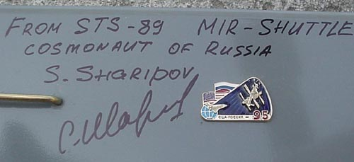 # sm127            Mir-Shuttle model autographed-notared by cosmonaut Sharipov 2