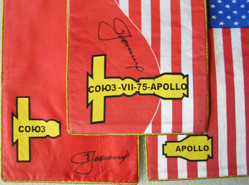 # astp096            ASTP commemorative flags signed by Leonov 5