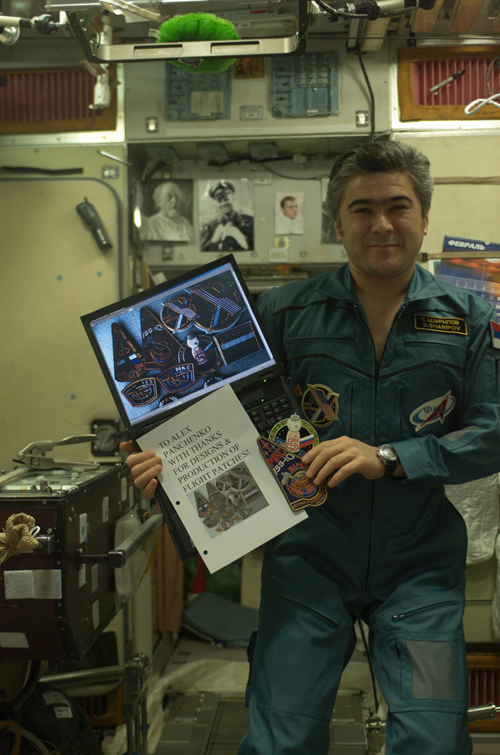 # spp099a            ISS-10, Soyuz TMA-5 patches on board station 3