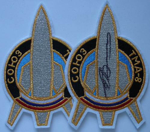 # spp089b            Soyuz TMA-8 patch for official photo 1