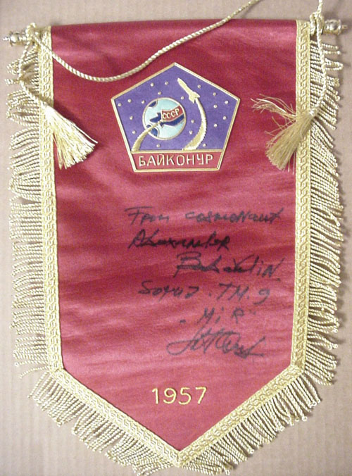 # pnt132            Baikonur pennant autographed/notared by A.Balandin 1