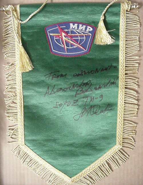 # pnt140            Space Station MIR logo pennants signed/notared by MIR cosmonaut A.Balandin 1