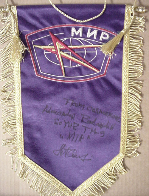 # pnt140            Space Station MIR logo pennants signed/notared by MIR cosmonaut A.Balandin 3