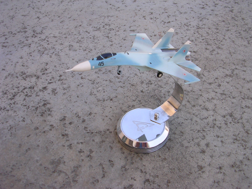 # sp203a            Su-27 on chrome stand with Sukhoi logo 1